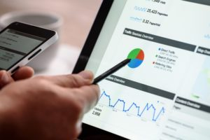 Person with pen pointing at Google Analytics on laptop | top seo company in pennsylvania | VIEWS Digital Marketing